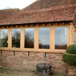5 large windows brown timber