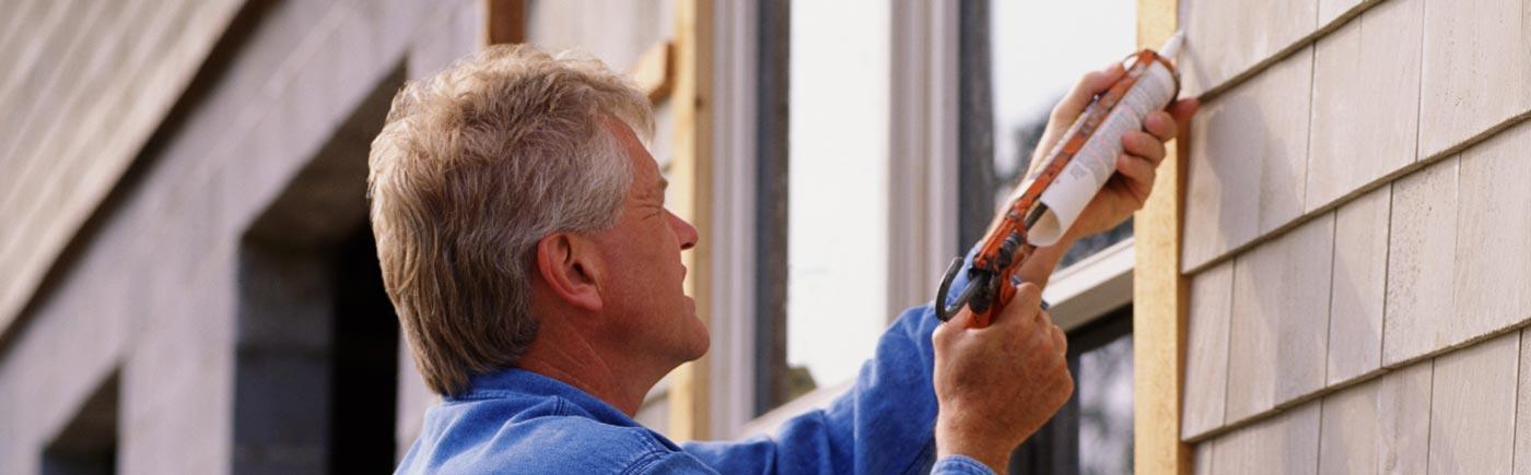 man repairing sash window