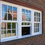 three sash windows with one open