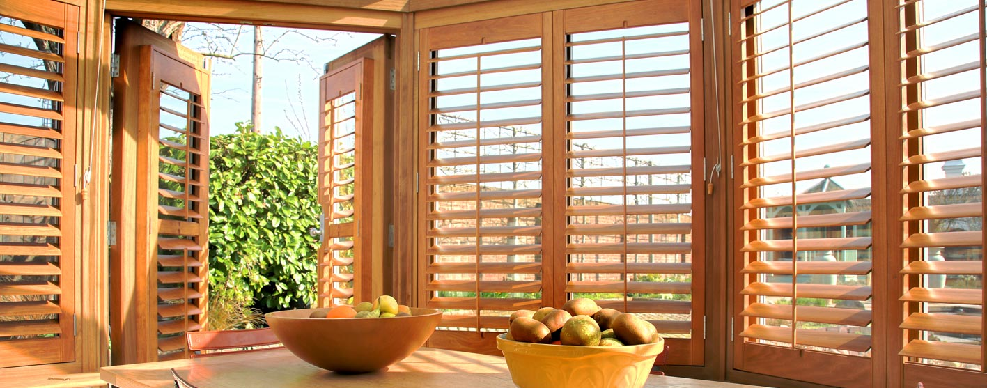 brown sunlit shutters with fruit bowls